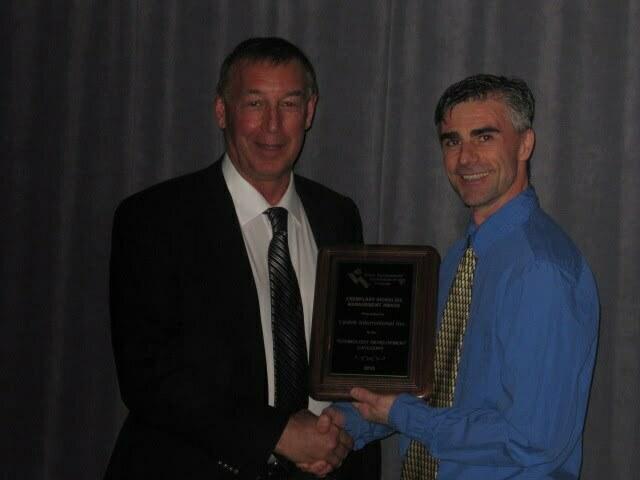 WEAO Award  Gary Burrows - WEAO President & Rick Mosher - Lystek President  2013
